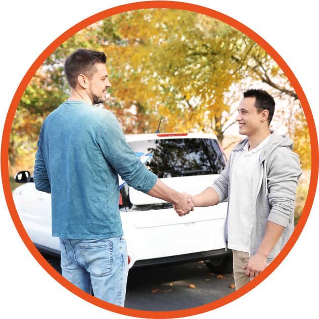 young male learner driver with instructor