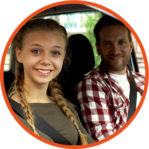Young girl and dad in car