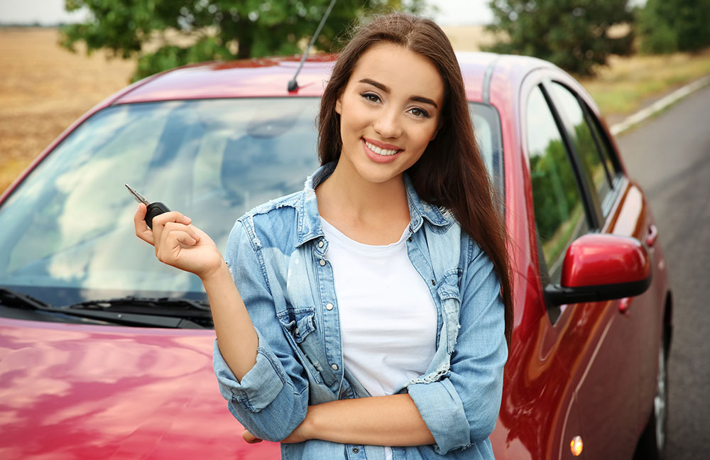 young girl holding car key