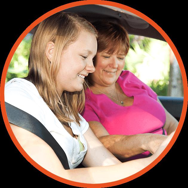 mum teaching daughter in car