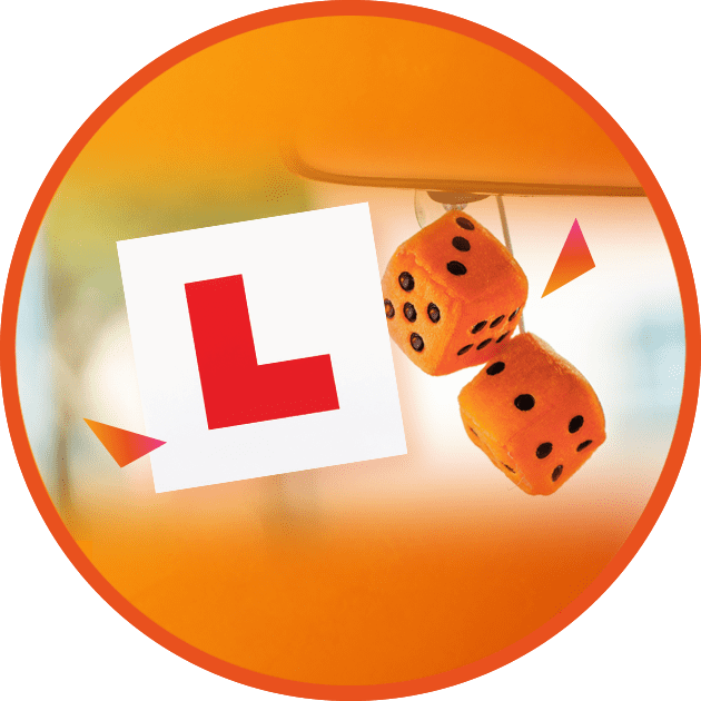 L plate in window with dice in car