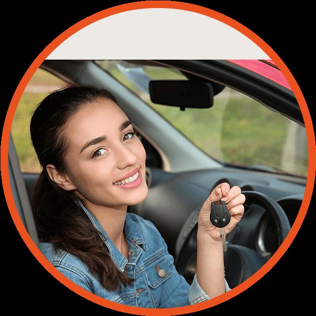 girl in car holding keys