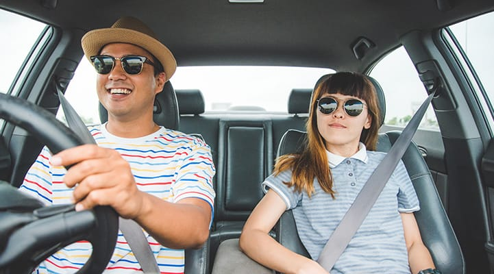 young man and girl in car driving
