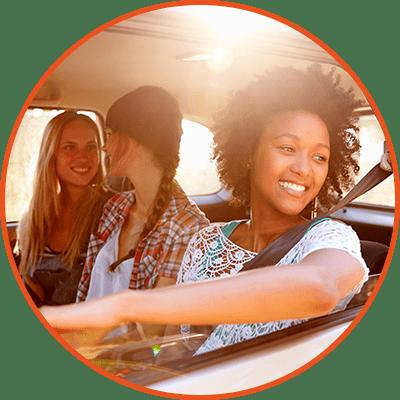 happy teenage customers in car