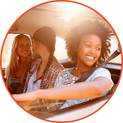 young happy girls in car