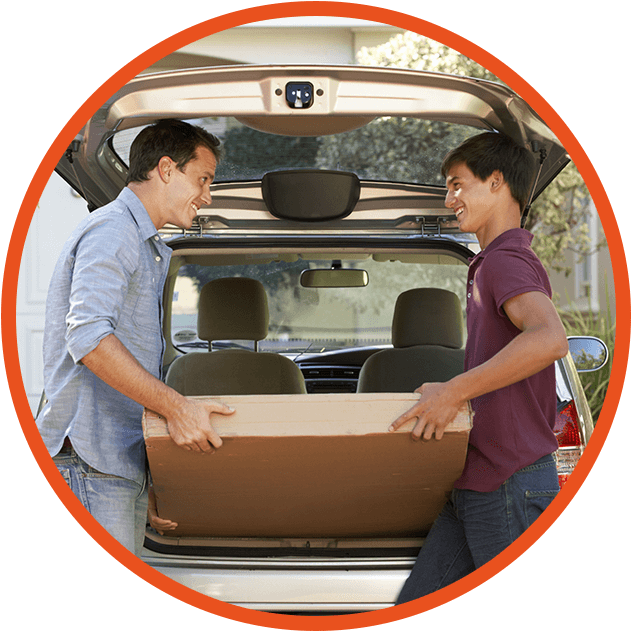 young boy and dad packing car for college