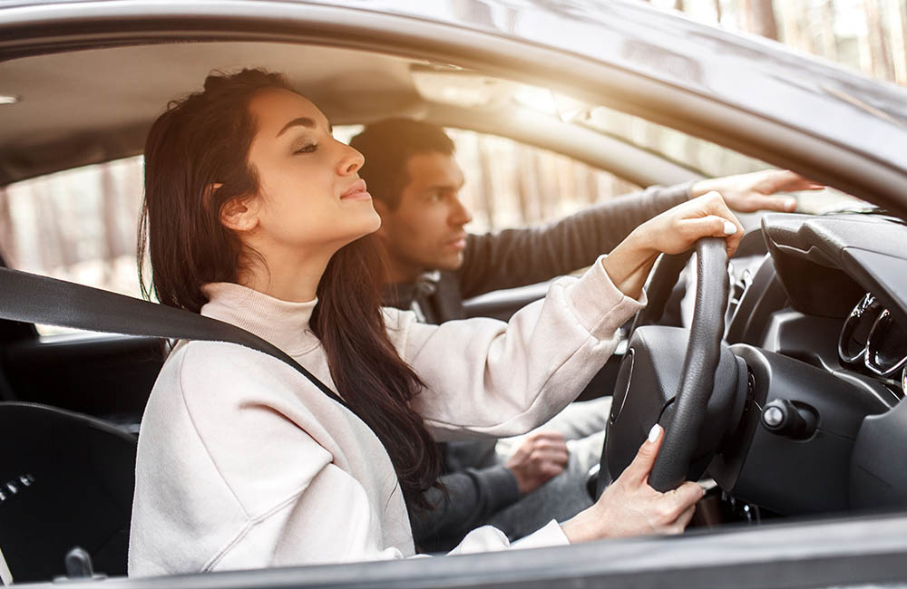 young girl driving learning