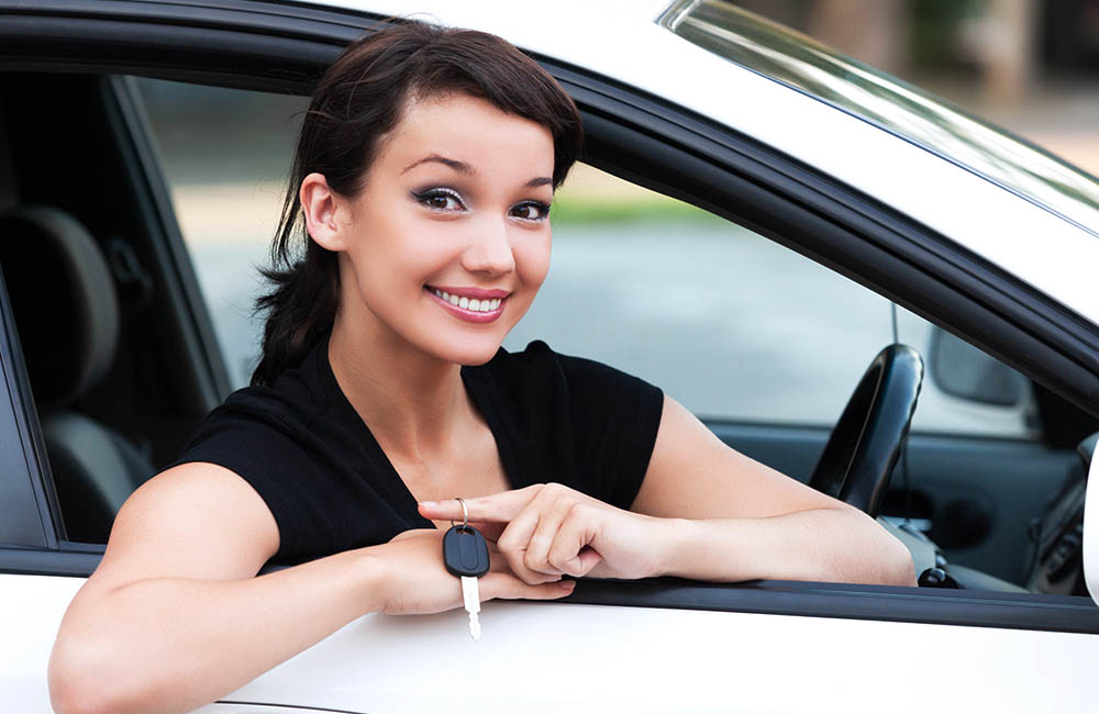 teen girl driving car